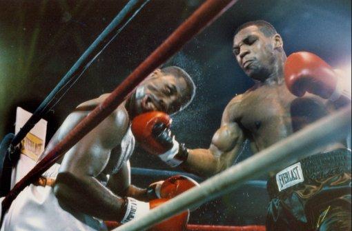 Майк Тайсон провёл самый короткий бой в карьере против Марвиса Фрейзера